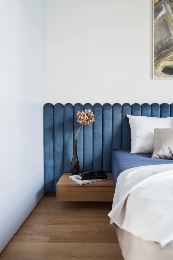 a modern bed with an extended channel tufted blue headboard is a stylish idea that will cozy up the bedroom