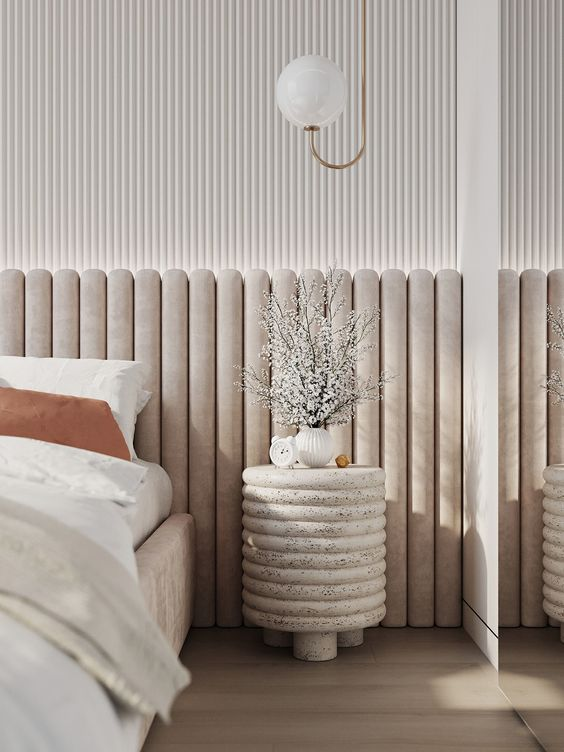 a neutral velvet upholstered bed with an extended channel tufted headboard that adds style to the room