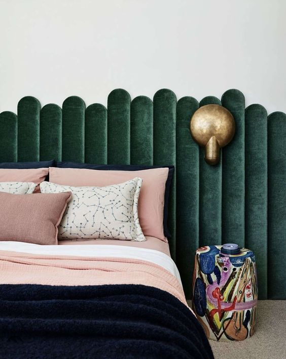 a pretty green velvet channel tufted headboard with mismatching parts looks eye-catchy and chic