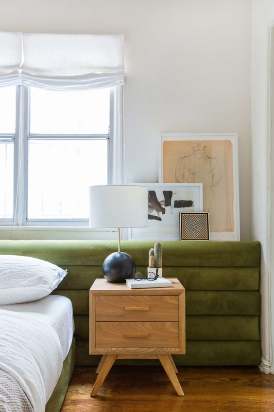 a green velvet bed with a super extended horizontal channel tufted headboard will make your bedroom look refined