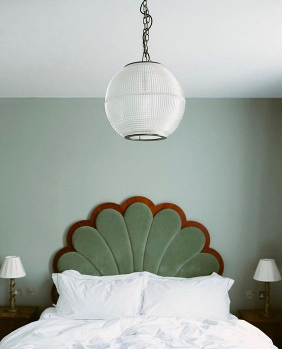 a cool green velvet headboard shaped as a flower is a lovely art deco idea for a bedroom