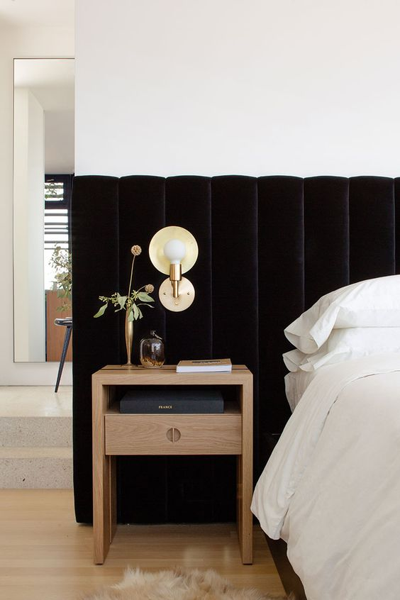 a black velvet challe tufted headboard taking the whole wall will add an exquisite touch to the space