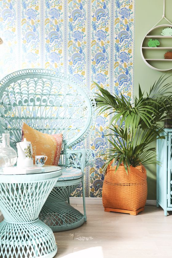 a mint-colored peacock chair and a matching table plus some potted statement plants will make your space feel veyr boho-like