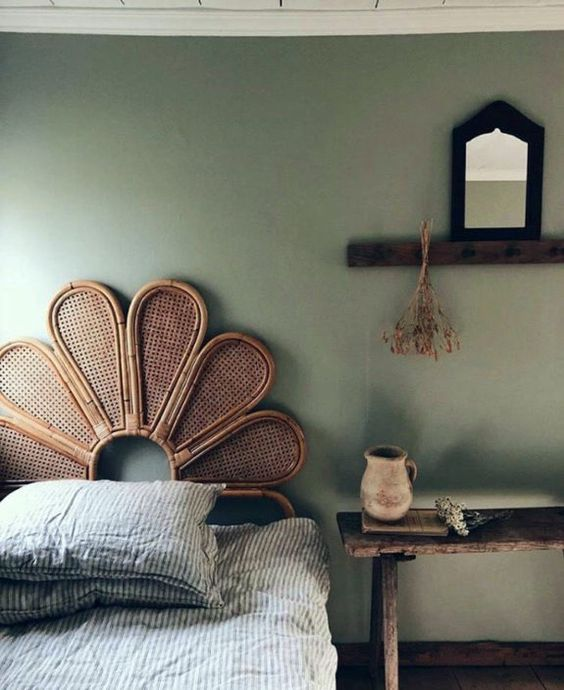 a rattan headboard is a trendy solution for a boho space, and this one reminds of peacock chairs