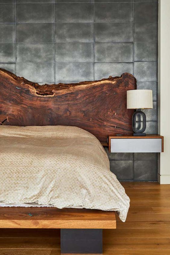 a live edge wooden headboard is still in trend and it will look especially cool in refined and luxurious bedrooms