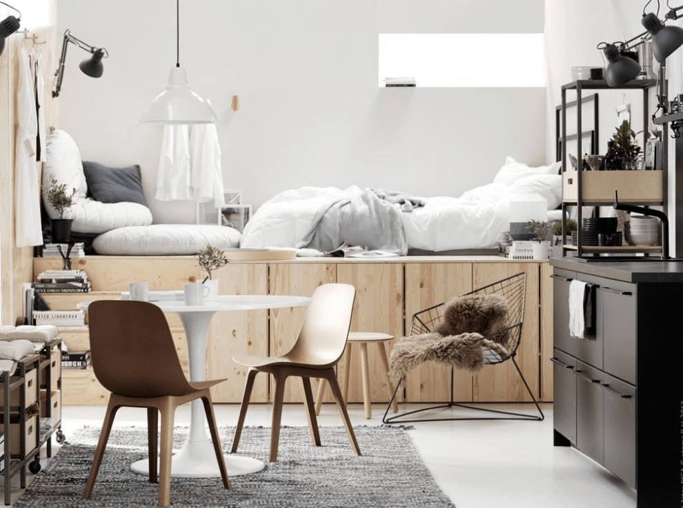 a Scandinavian studio apartment with a bed raised on storage units is a very clever and cool idea