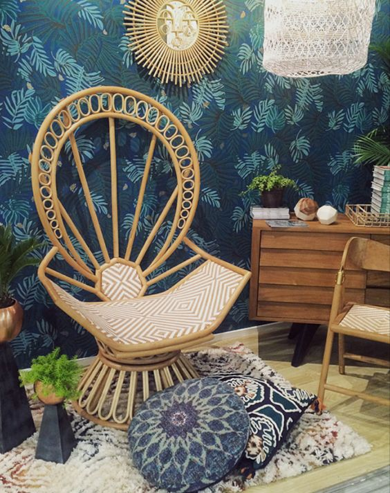 a very creatively shaped peacock chair with geometric upholstery is a statement furniture piece for a boho space