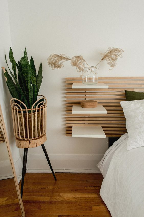 an airy wood slat headboard for adding a modern feel to the room and for attaching floating nightstands