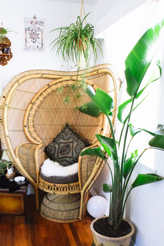an extended peacock chair with faux fur, a boho pillow is a very creative and chic idea for a boho space