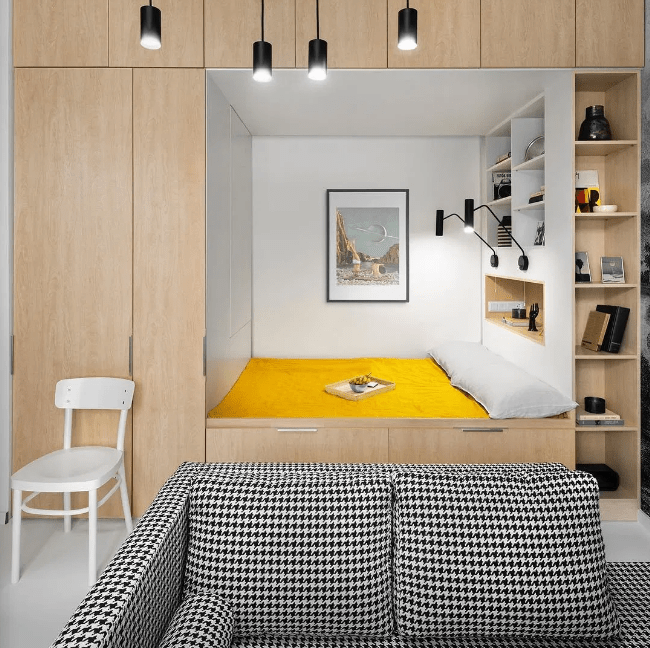 a stylish solution of building a bedroom into a sleek storage unit will help you keep it more private and separated