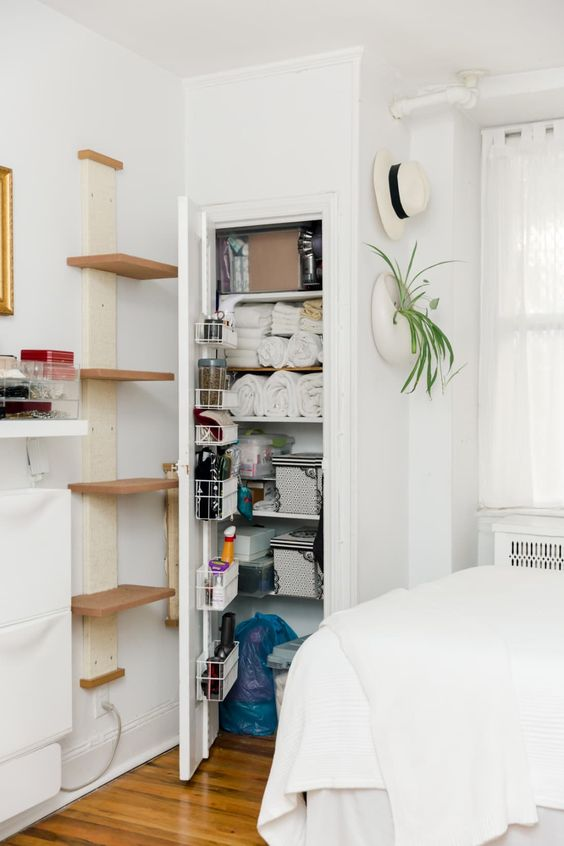 a tiny hidden pantry helps to keep the clutter out, and a vertical shelf allows storing various small stuff
