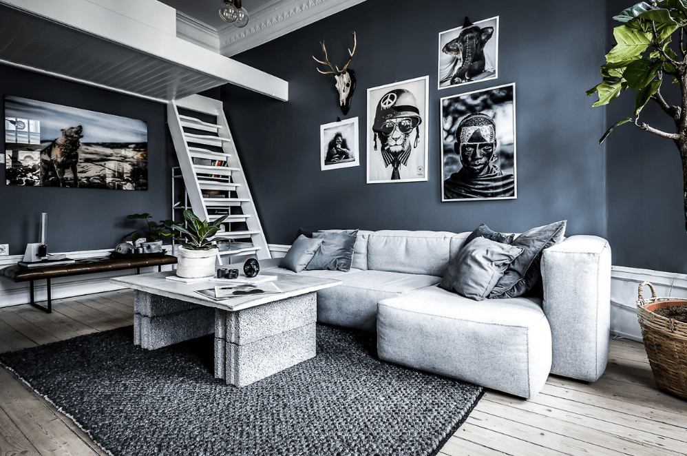 a monochromatic gallery wall with large scale art pieces is a stylish and chic idea for a studio apartment