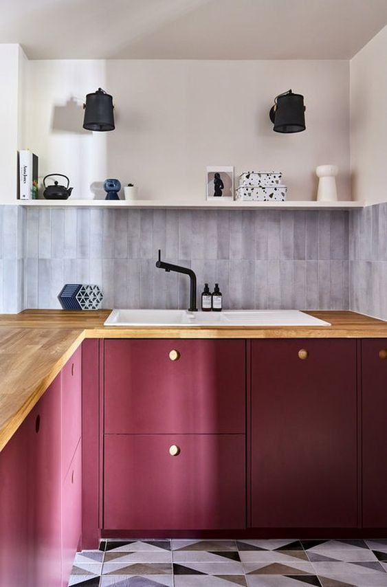 a bold purple kitchen with butcherblock coutnertops, a grey skinny tile backsplash and an open shelf