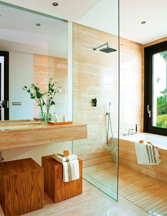 a chic bathroom with a wooden vanity, a wooden floor and wood in the shower-bathtub zone is cool