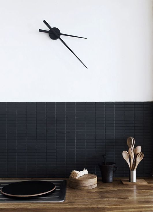 a chic matte black mini tile backsplash looks sleek and adds texture and interest to the space making it bold and pretty