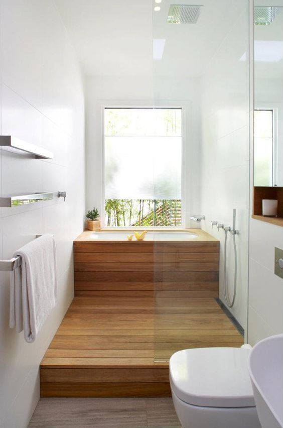 a contemporary bathroom in neutrals, with a soak tub clad with wood and a wooden platform in the shower space