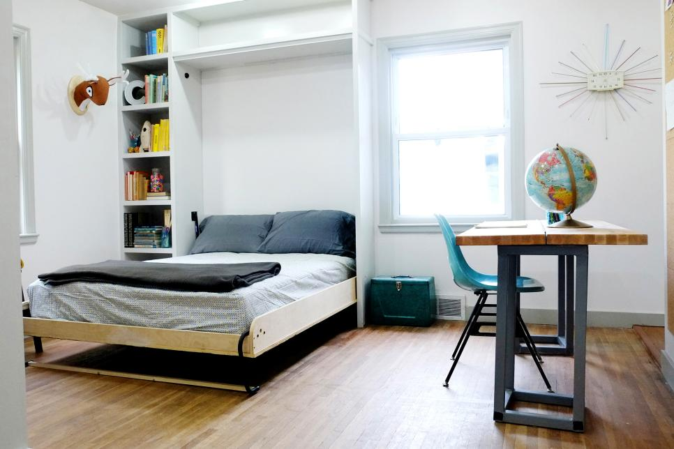 a cool kid's bedroom with a built in storage unit and a Murphy bed, a desk and a chair is an easy idea