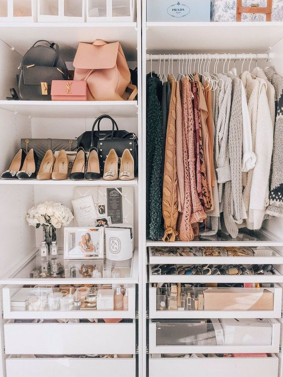 a cool wardrobe with open compartments, sheer and usual drawers, open shelves and boxes for storing things