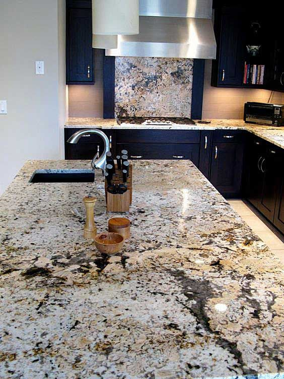a delightful navy kitchen with a granite backsplash and countertops plus modern stainless steel appliances is amazing
