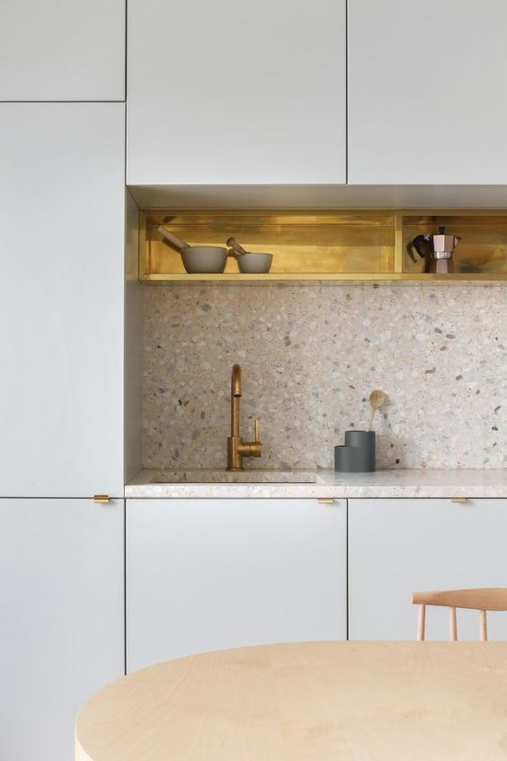 a dove grey kitchen with gold touches for more chic and a neutral terrazzo countertop and a backsplash is amazing