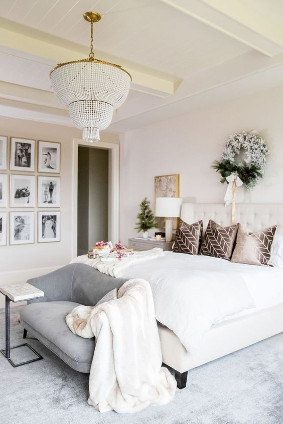 a grey loveseat with a curvy back matches the glam and chic bedroom in neutrals and adds a subtle touch of color