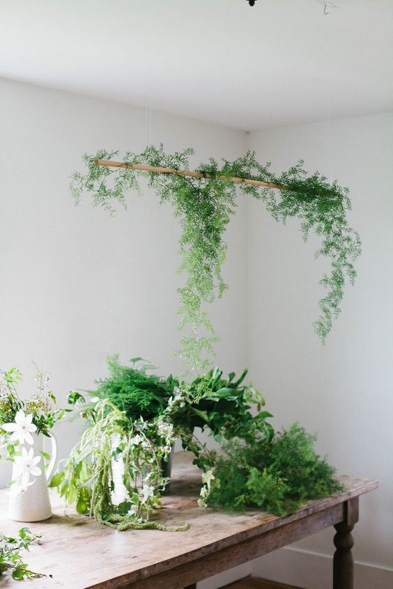 a hanging greenery centerpiece will be an amazing idea for your spring dining space and you can make it anytime