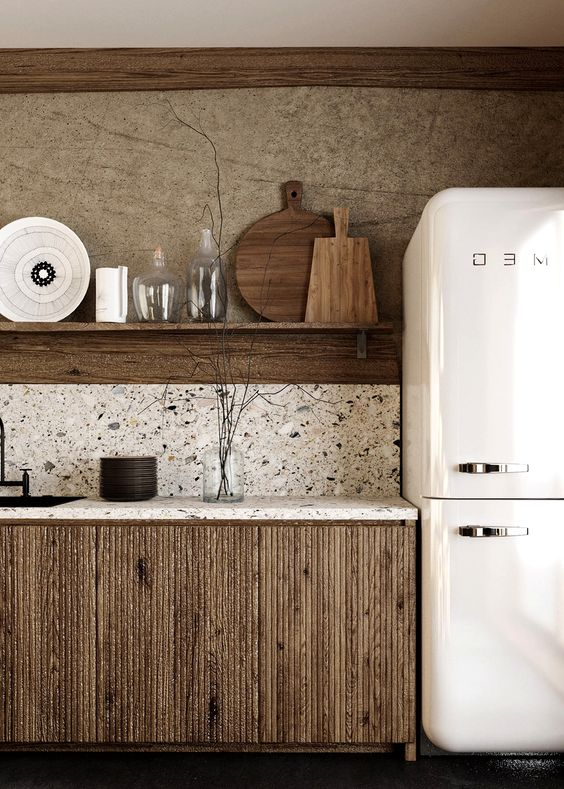 a laconic wabi-sabi kitchen with dark stained cabinets, white terrazzo coutnertops and a backsplash plus an open shelf instead of upper cabinets