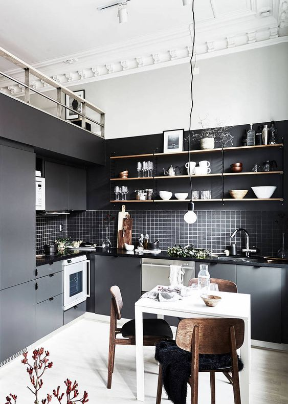 a stacked tile backsplash in black fit perfect this nordic kitchen