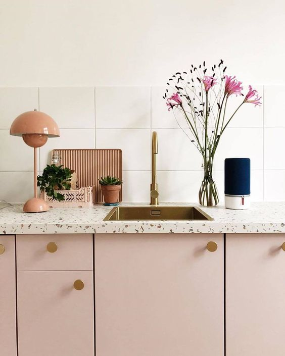 a lovely pink kitchen with white terrazzo countertops and brass touches is a very girlish and pretty idea