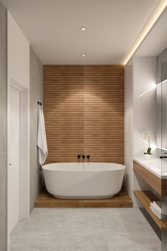 a minimalist bathroom with an accent wall done with wood that creates a spa feel in the space