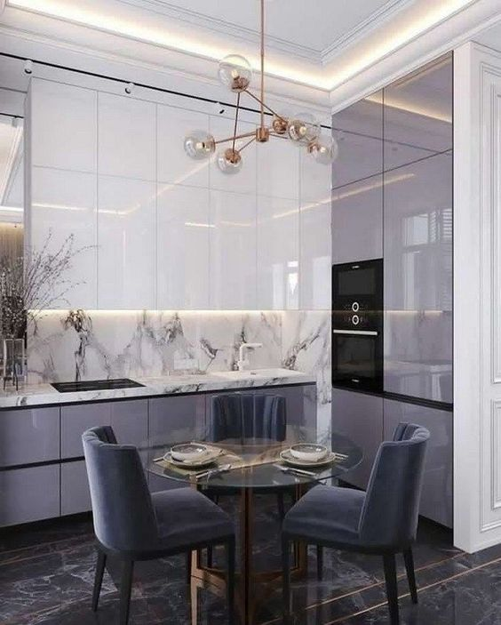a minimalist lilac kitchen with white upper cabinets, a white stone backsplash and countertops plus lilac chairs