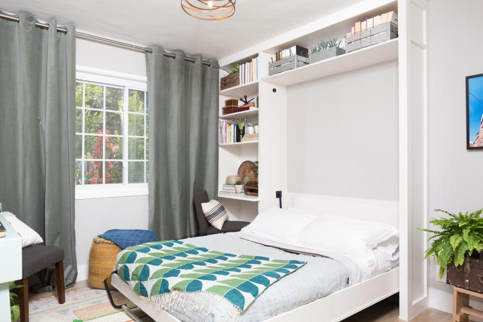 a neutral guest bedroom with a large storage unit and a Murphy bed, some chairs and lovely textiles