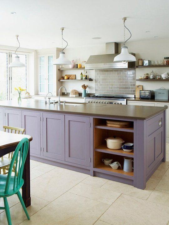 a neutral kitchen with a lavender kitchen island, taupe countertops and retro pendant lamps plus a grey tile backsplash