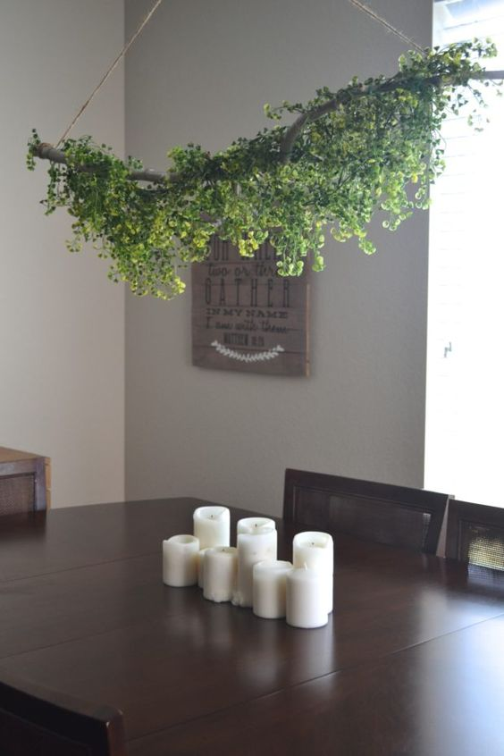 a pretty greenery installation over the table will make your dining space feel very spring-like and very welcoming