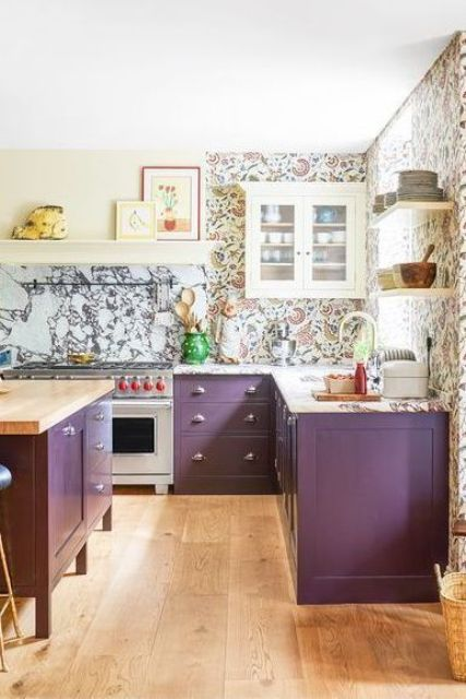 a refined purple kitchen with a wallpaper wall, a white stone backsplash and coutnertops and neutral appliances