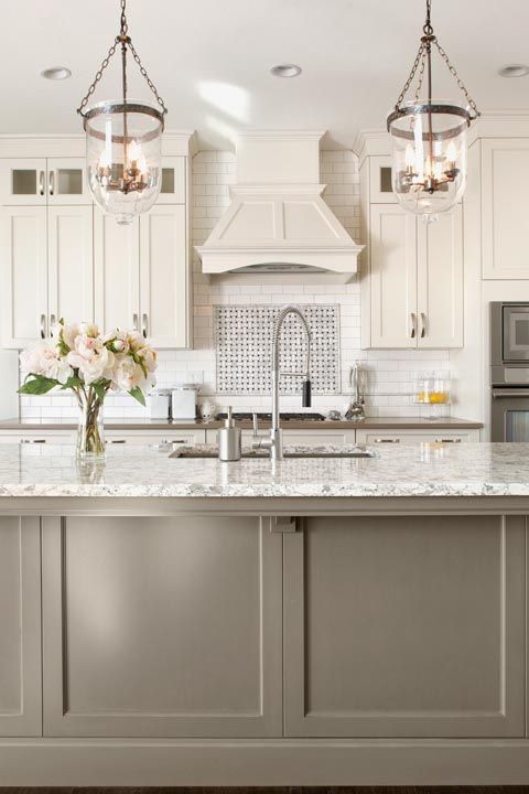 a cozy kitchen with a practical kitchen island