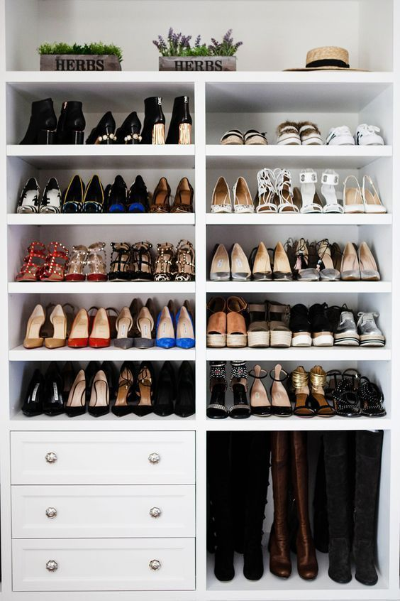 a shoe rack with open shelves, drawers and an open comartments for tall boots is a very cool idea with much organization