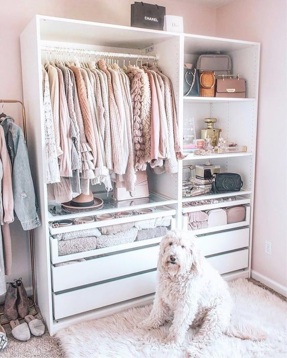 a small and comfortable closet with an open clothes holder, open compartments for bags, accessories and makeup and drawers