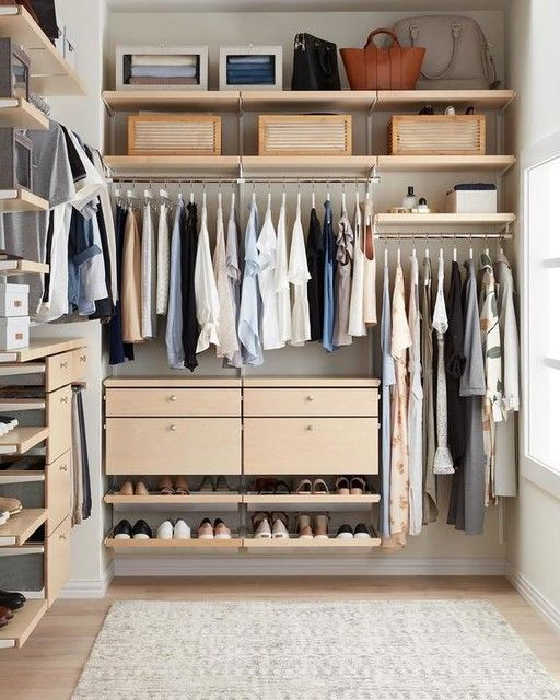 a small and stylish closet with holders, drawers, open shelves for shoes and bags and wooden boxes to match the space