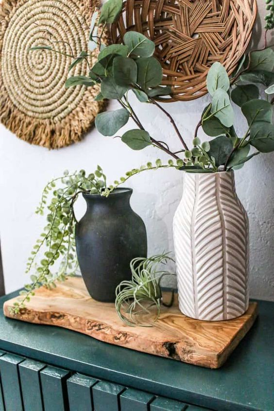a spring arrangement of fancy vases with greenery and an air plant is a cool idea for a boho space