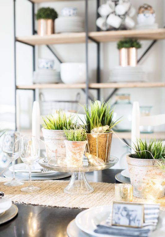 a stand with potted greenery, lights is a pretty and easy last minute spring centerpiece you can DIY