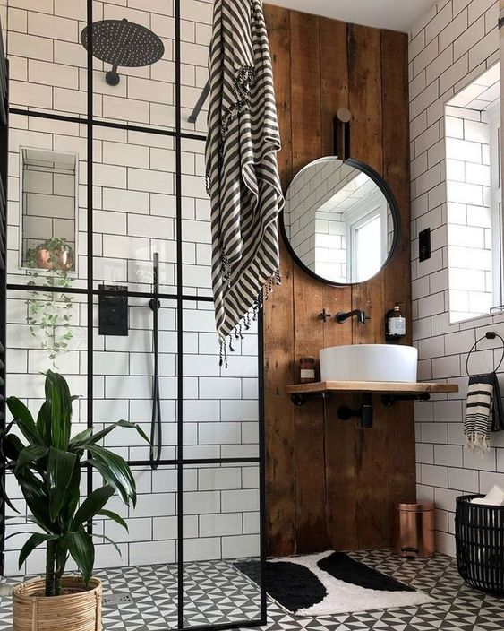 a stylish boho bathroom with a wooden accent wall that shows off the sink is small yet very cool