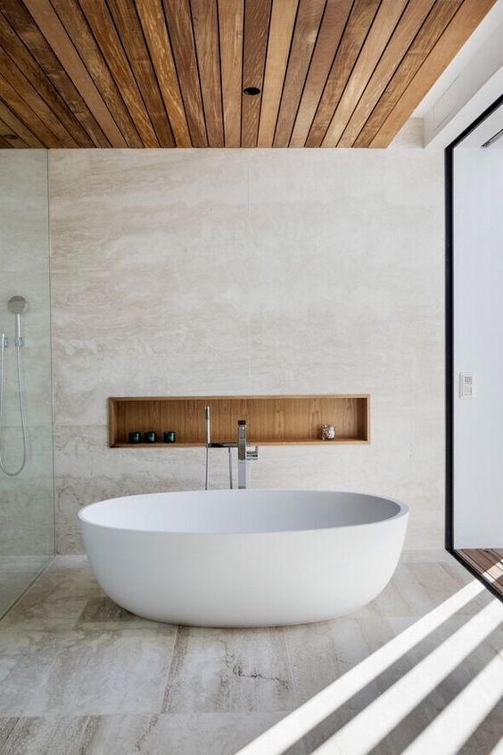 a stylish minimalist bathroom with a wooden ceiling, a wood clad niche looks luxurious and chic
