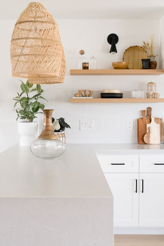 a warm organic white kitchen with ribbed tile and light grey quartz countertops plus touches of black for a contrast