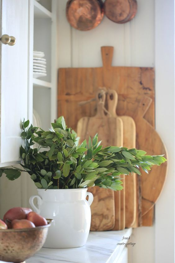 a white vase with greenery is a timeless idea to bring a spring feel to the kitchen or any other space anytime