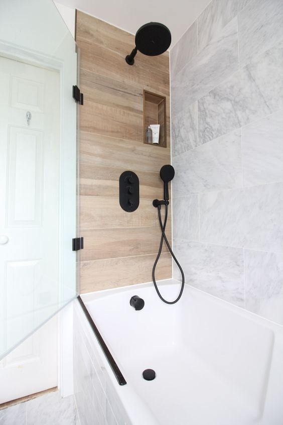 marble can be paired with wood-like tiles to create a chic and luxurious space, add black fixtures for a modern feel