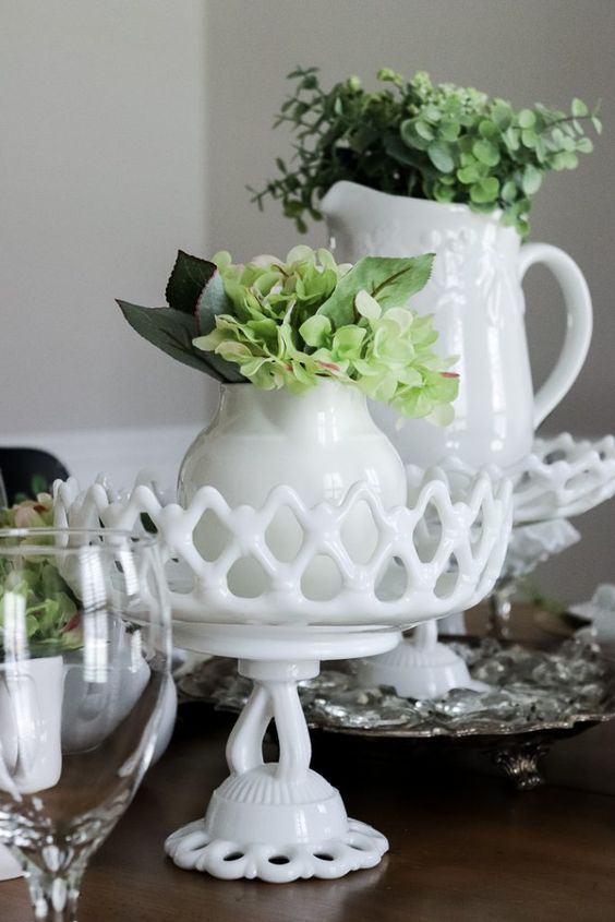 vintage jugs with greenery and foliage will give a vintage spring feel to the table, they can be used as centerpieces