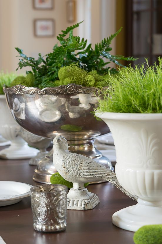 vintage urns and bowls with moss, greenery, foliage and grass are great for an elegant spring tablescape