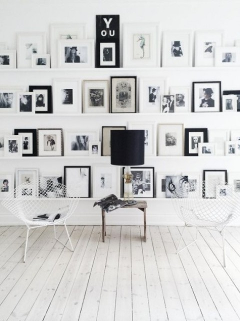 02 a black and white gallery wall with black and white frames and artworks and IKEA Ribba