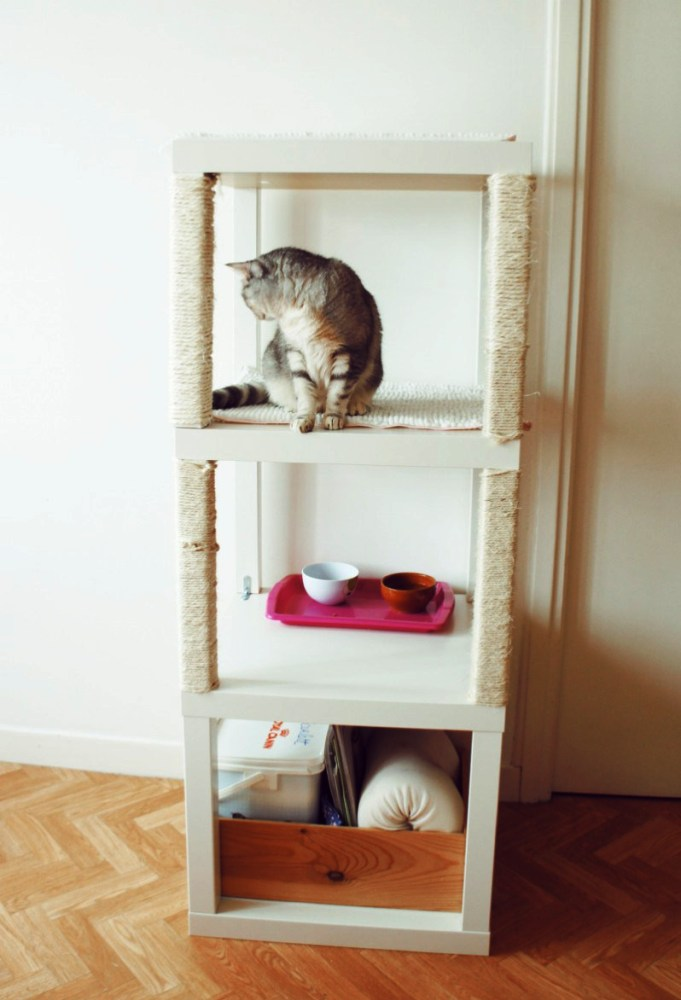 a cat condo made of three IKEA Lack tables, with scratchers, an eating zone and a storage space underneath is a pretty idea